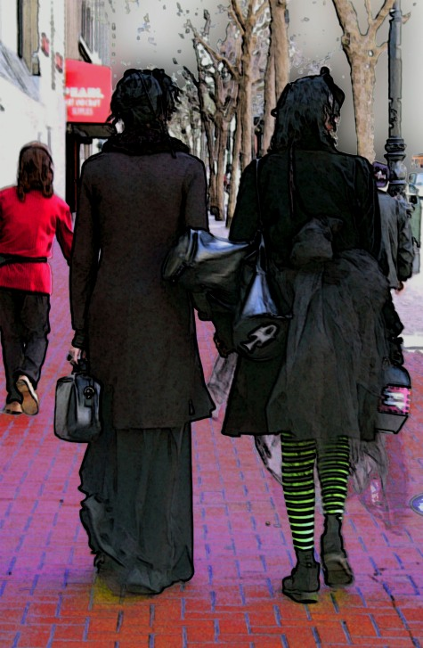 Couple dressed in goth black on Market Street in San Francisco