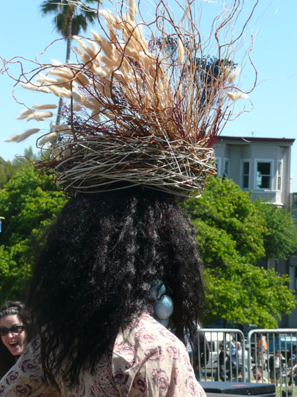 Black person with bird's nest hat