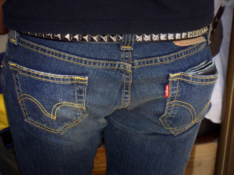 closeup of blue jeaned butt with metal belt