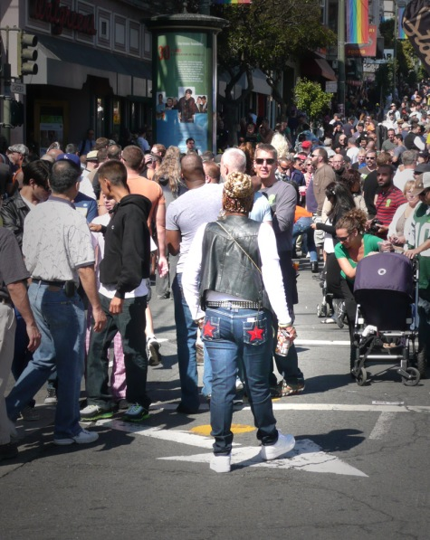Castro Street Fair crowd with woman with braids and red stars on jeans