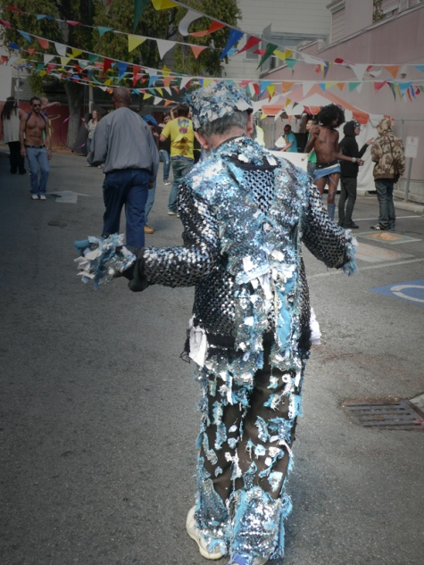 Man in silver suit dancing
