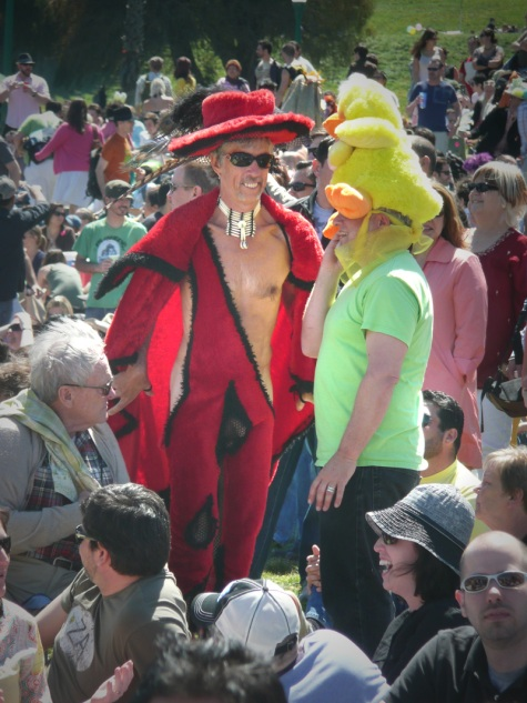 man in red costume with crotch cut out and replaced with fishnet
