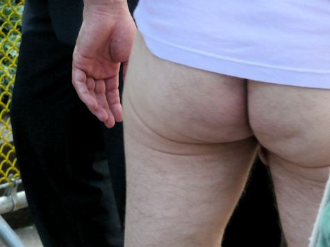 photograph of man's bare bum at st stupids day parade in san francisco