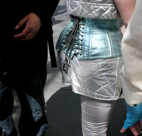 fine art photograph by san francisco artist sarah curtiss of woman in silver with a metallic turquoise corset