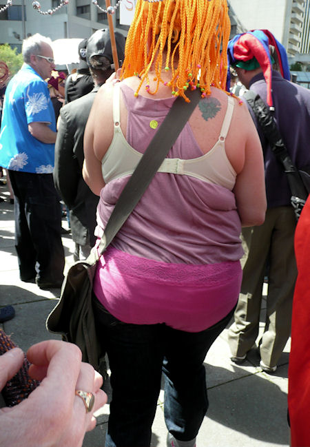 woman in orange wig with pink underwear over her clothes