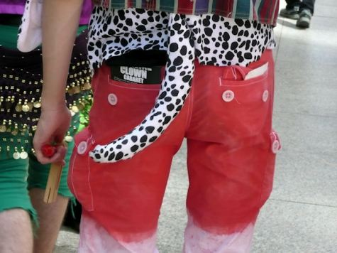 red pants with a black and white leopard tail