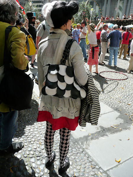 woman with checkered tights and matching bag and hair