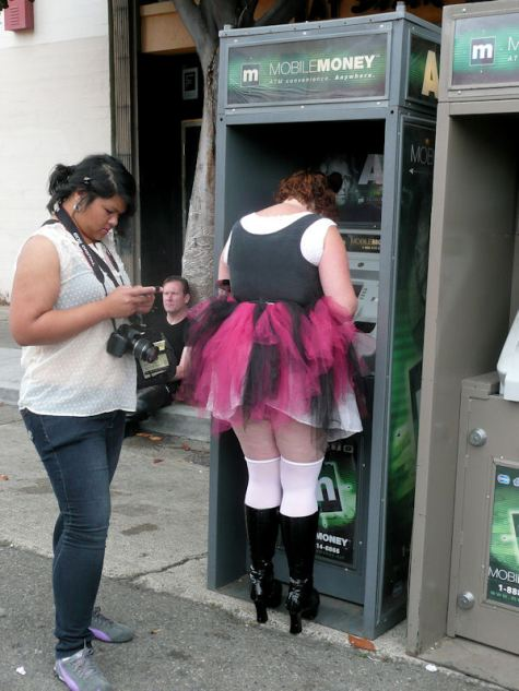 woman in pink tutu at the money machine