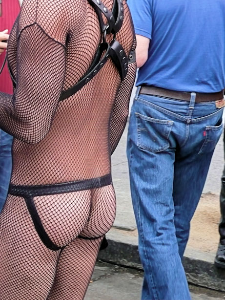 man in full body fishnet