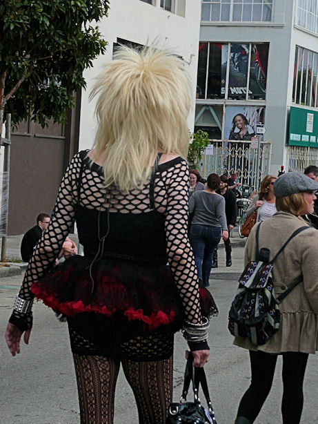 big blond with black corset and tutu