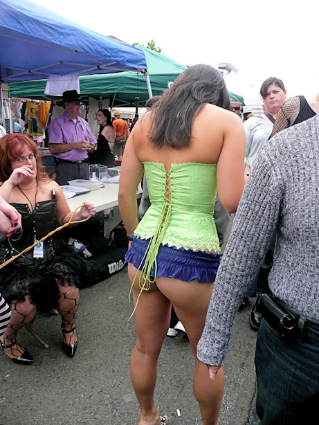 woman in green corset with purple thong