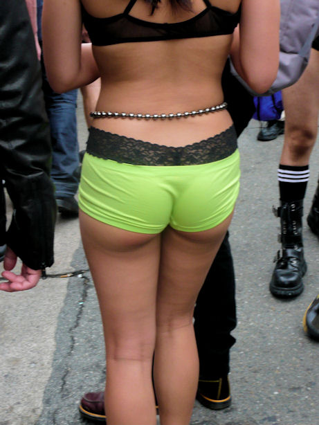 woman in lime green short short shorts