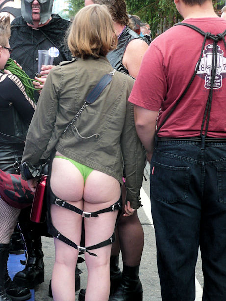 woman in green thong with leather accessories