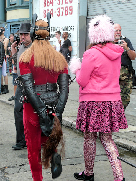 woman dressed as red horse with pink cat